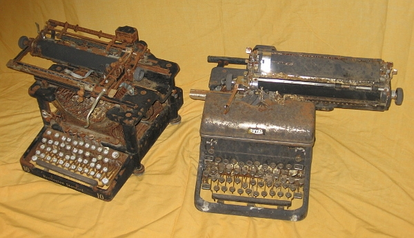 The Remington Standard 10 is on the left in this pic. It is filled with leaves and other barnyard debris.