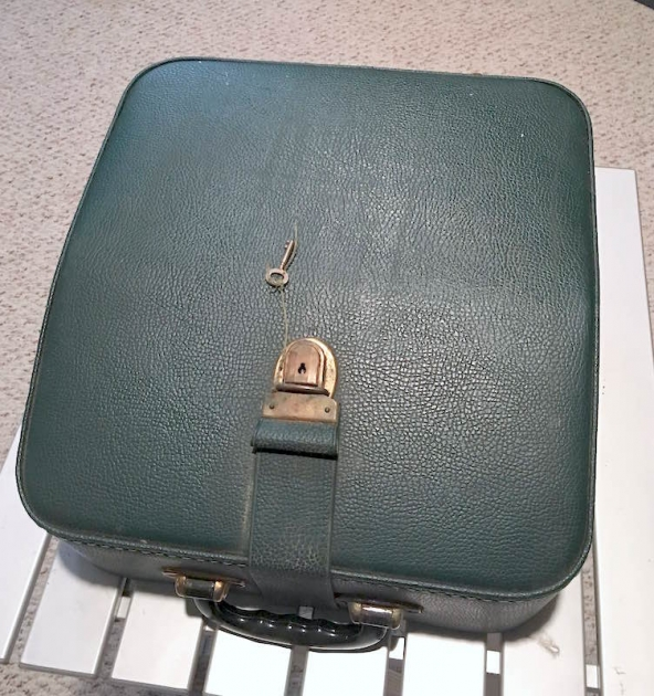 The green leather case has a key!