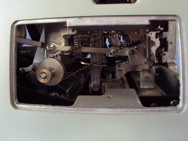 The right side, showing the unusual chain drive for the ribbon advance.