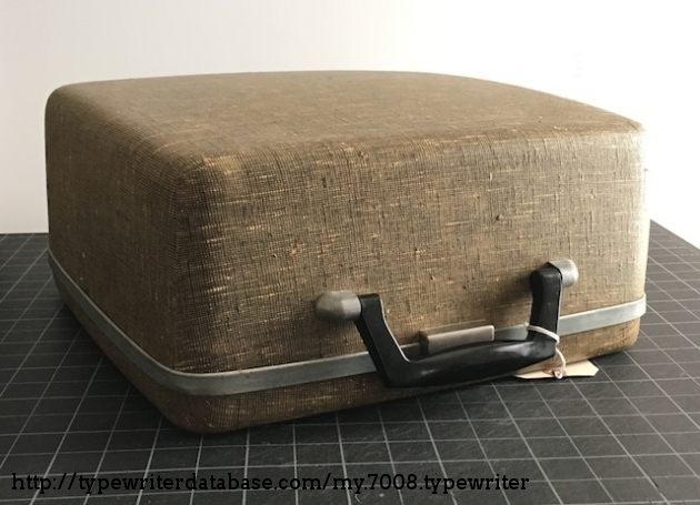 The case appears to be reinforced with resin/fiberglass cloth, almost like Samsonite luggage from the era.