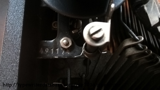 Serial number on the left side under the hood, near the ribbon spool.