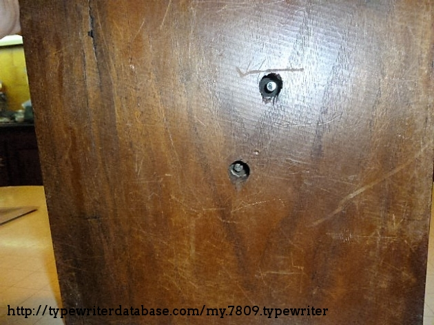 the holes underneath the wooden base are neccesary in order to operate the typewriter