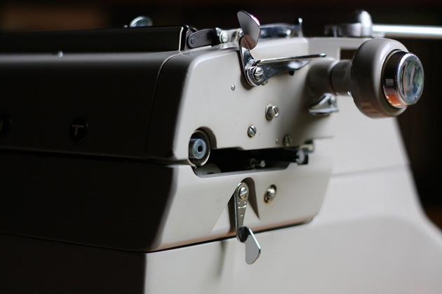 The lever switch on the lower left hand side of the carriage operates the keyset tabulator; the one on the other end of the carriage activates the pre-set tabulator stops and clears all stops
