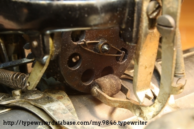 The type cylinder then pushes the ink roller out of the way and hits the platen.