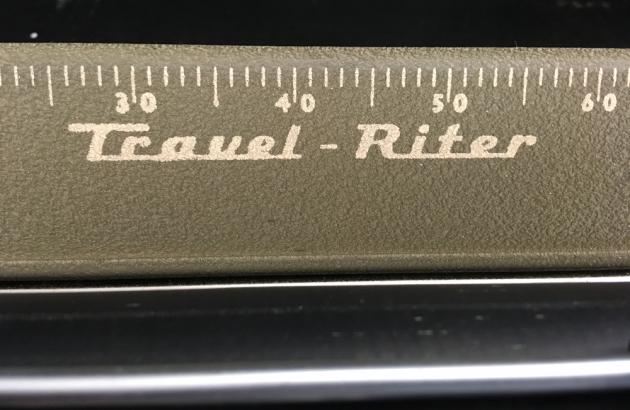 """Remington """"Travel-Riter"""" logo..."""