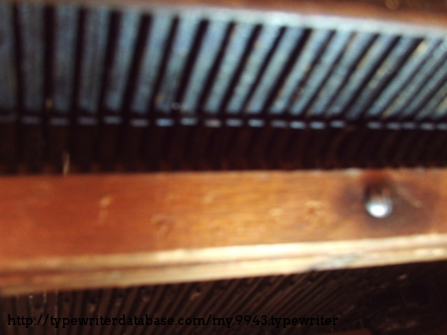 Under the typewriter, on the back-side in the wood, Remington also stamps the serial number; matching the one stamped into the metal case body.