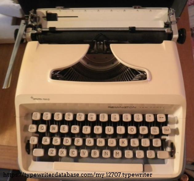 Cream coloured portable typewriter -- rather uninteresting